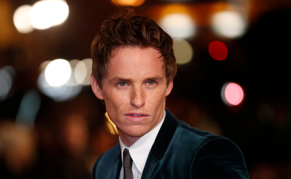 Description of . Actor Eddie Redmayne poses for photographers as he arrives for the world premiere of