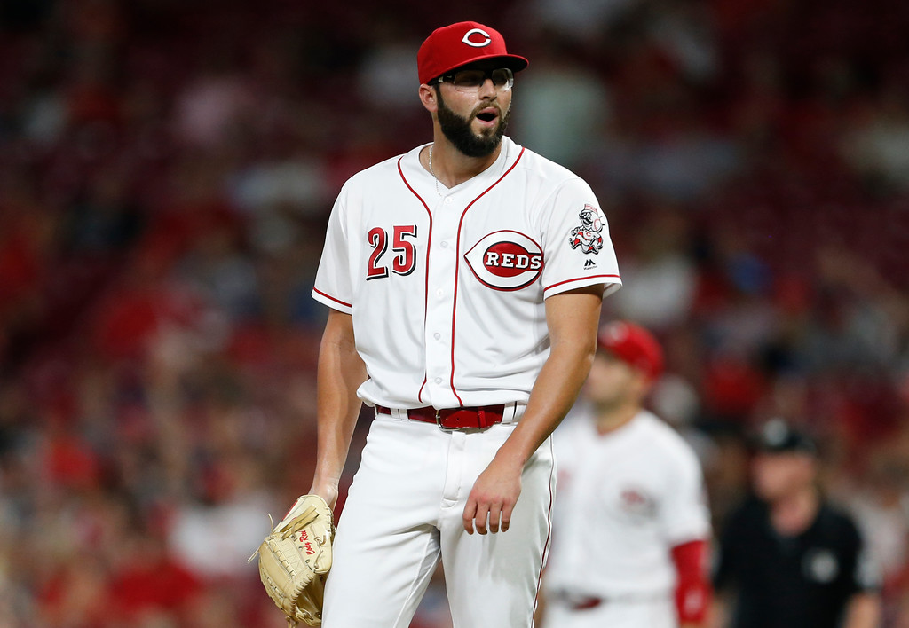 . Cincinnati Reds relief pitcher Cody Reed reacts to giving up a two-run home run to Cleveland Indians\' Melky Cabrera during the sixth inning of a baseball game Wednesday, Aug. 15, 2018, in Cincinnati. (AP Photo/Gary Landers)