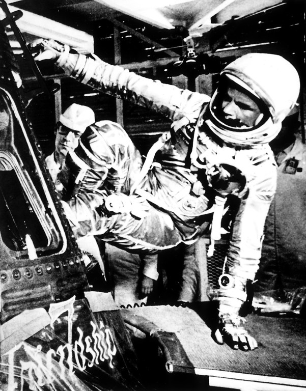 . FILE � In this Feb. 20, 1962, file photo, U.S. astronaut John Glenn climbs inside the capsule of the Mercury spacecraft Friendship 7 before becoming the first American to orbit the Earth, at Cape Canaveral Air Force Station in Cape Canaveral, Fla. Nate D. Sanders Auctions says in-flight instructions used by former U.S. Sen. John Glenn, D-Ohio, as he became the first American to orbit the Earth sold for $66,993 on Thursday, July 21, 2016, in Los Angeles. (AP Photo, File)