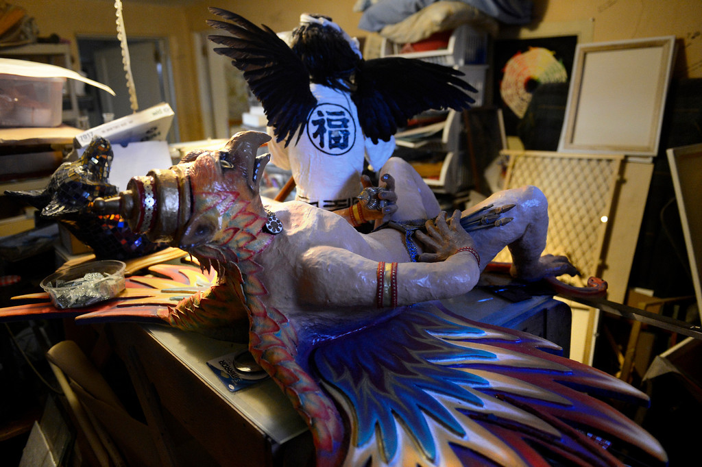 . Edgewater, CO. - January 28:  A Hindu deity, Garuda, and a Crow Tengu are ready for a comeback in a storage room in the home of artist Dede LaRue in Edgewater, Colorado. January 28, 2013. (Photo By Joe Amon / The Denver Post)