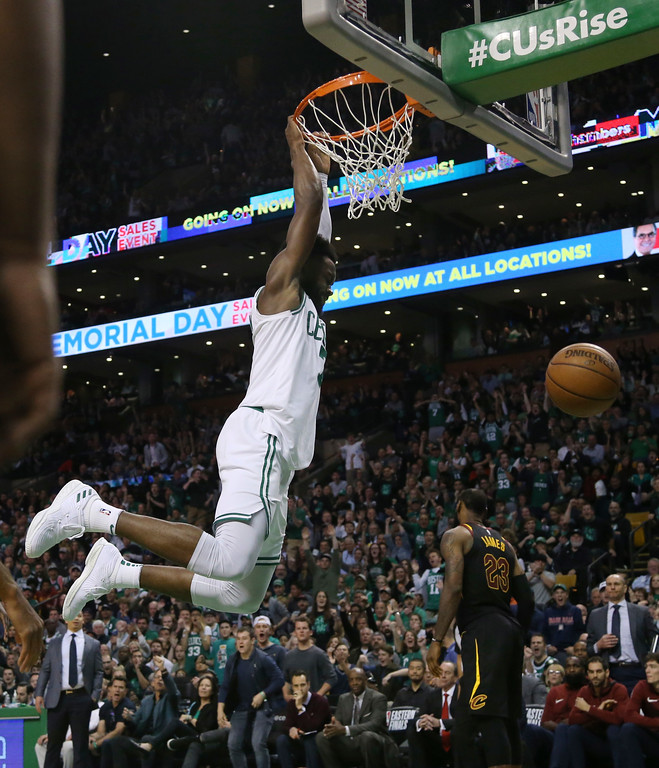 . Boston Celtics guard Jaylen Brown dunks against the Cleveland Cavaliers during the second half in Game 7 of the NBA basketball Eastern Conference finals, Sunday, May 27, 2018, in Boston. (AP Photo/Elise Amendola)