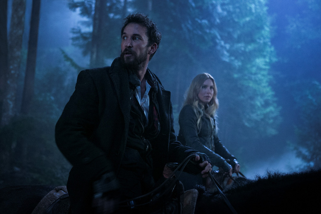 . Tom (Noah Wyle) and Maggie (Sarah Carter) keep a look out on one of their missions. Photo Credit: James Dittiger