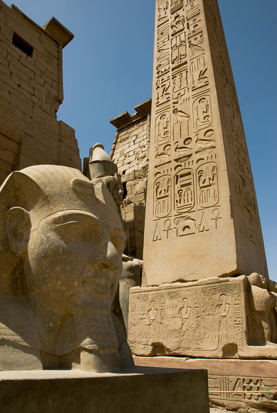 Obelisk and face of a Sphinx at the Luxor Temple - Luxor, Egypt