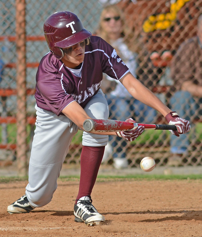 . Torrance\'s Brendan Raymundo (8) lays down a bunt against West in a non league baseball game at West. After a scoreless game through five, West went on to win 7-4. 20130314 Photo by Steve McCrank / Staff Photographer