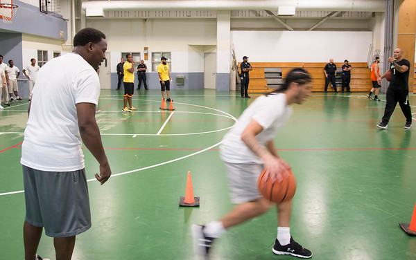08/14/19 Wesley Bunnell | StaffrrThe Manson Youth Institution is implementing a basketball league, based off the New Britain Legacies Youth Development & Basketball Program, for inmates aged 14 to 21 to have a chance to play organized basketball with the qualification that inmates abide by the strict rules of the facility. Correctional officer and program coach, Tim Thomas, looks on as a inmate runs through a drill. r