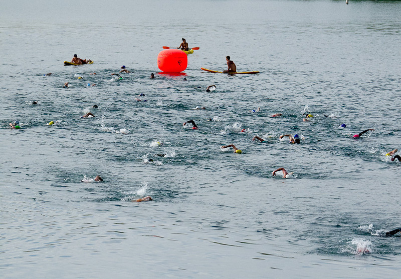 Swimmers round the first buoy.