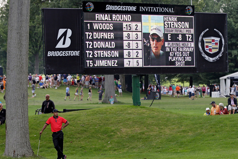 . Tiger Woods, lower left, waits to approach the third green during the final round of the Bridgestone Invitational golf tournament Sunday, Aug. 4, 2013 at Firestone Country Club in Akron, Ohio. (AP Photo/Mark Duncan)
