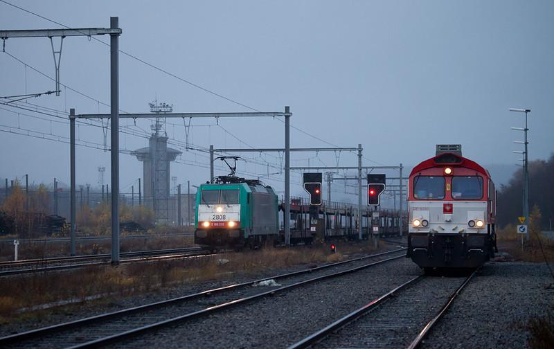 """December """"light"""". Crossrail DE 6310 """"Griet"""" and 2808 with empty autoracks in Montzen."""