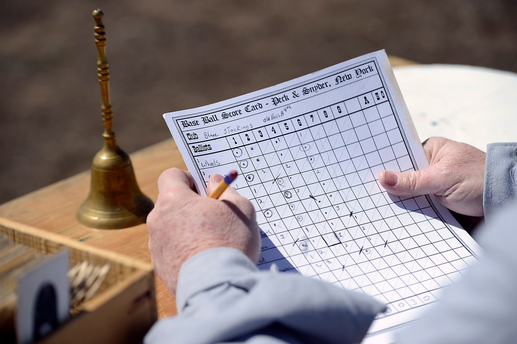 . DENVER, CO. - APRIL 14: Each player takes a turn keeping score during a vintage game agains the Central City Stars and the Denver Blue Stockings April 14, 2013 at  Riverside Cemetery in Denver. (Photo By John Leyba/The Denver Post)