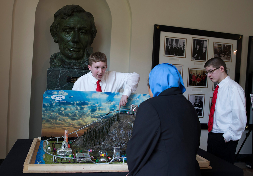. Josh Troutman of Bismark, N.D., left, and Tanner Schantz, of Bismark, N.D., show off their vision of the city of the future during the 2014 White House Science Fair, Tuesday, May 27, 2014, at the White House in Washington.  (AP Photo/ Evan Vucci)