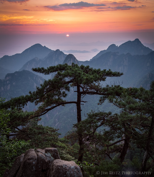 The sun rises over the Sea of Clouds - view from Huangshan (Yellow Mountain), China.