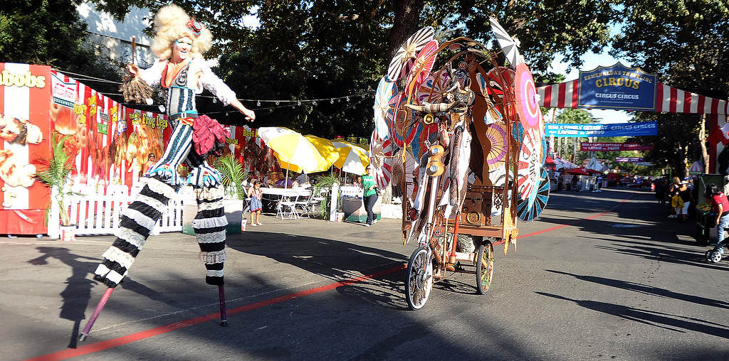 . Circus acts performs during the Diamond Bar community parade during the 91st Annual L.A. County Fair in Pomona, Calif. on Thursday, Sept. 5, 2013.   (Photo by Keith Birmingham/Pasadena Star-News)