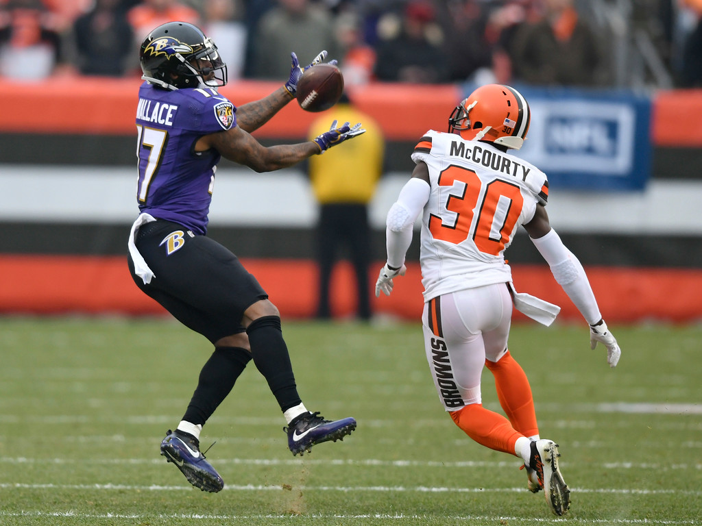 . Baltimore Ravens wide receiver Mike Wallace (17) catches a pass against Cleveland Browns defensive back Jason McCourty (30) during the first half of an NFL football game, Sunday, Dec. 17, 2017, in Cleveland. (AP Photo/David Richard)