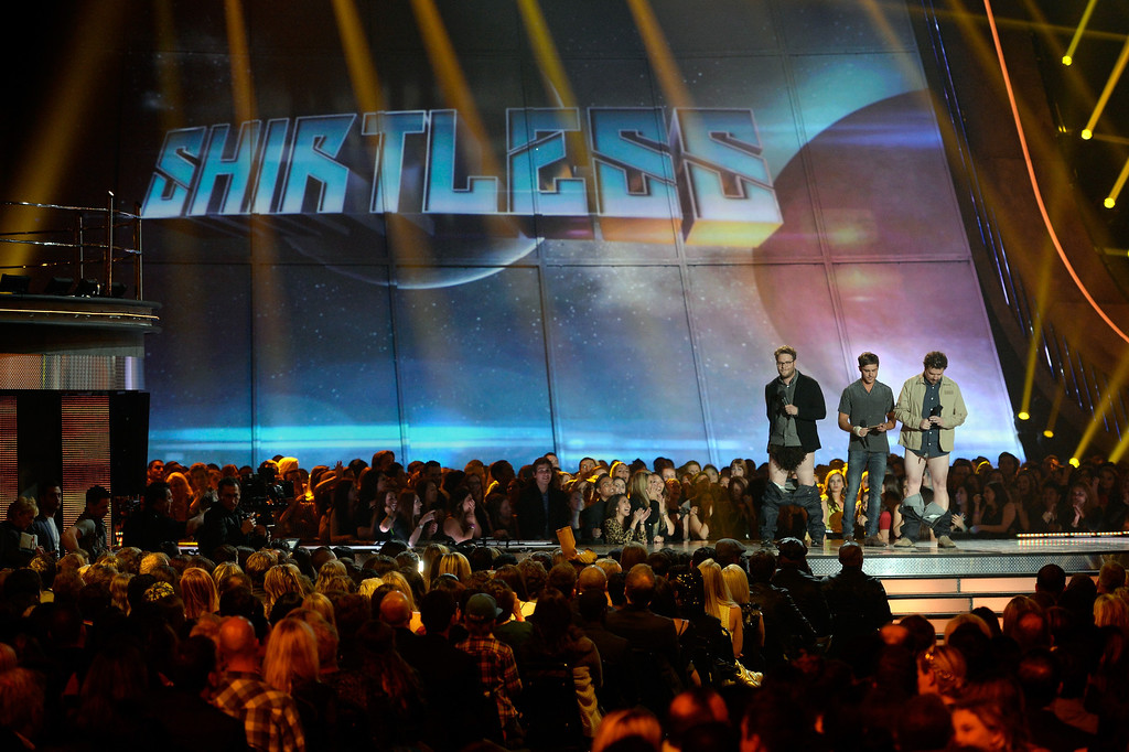 . Actors Seth Rogen, Zac Efron and Danny McBride speak onstage during the 2013 MTV Movie Awards at Sony Pictures Studios on April 14, 2013 in Culver City, California.  (Photo by Kevork Djansezian/Getty Images)