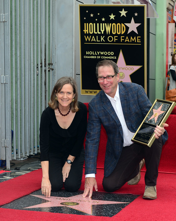 . Siblings of the late Janis Joplin, Laura (L) and Michael (R), pose beside the Janis Joplin star,during a ceremony on November 4, 2013 in Hollywood, California. Joplin, would have turned 70 years old this year and is the recipient of the 2,510th Star on the Hollywood Walk of Fame in the Category of Recording.         (FREDERIC J. BROWN/AFP/Getty Images)