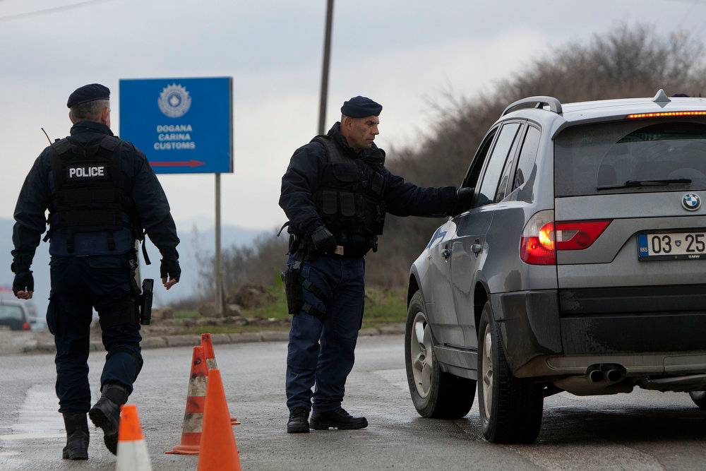 . Kosovo police stop vehicles in Hajvalia, a suburb of the capital Pristina in a search for illegal weapons  during an routine operation on Tuesday, April 9, 2013. The Balkan region is awash with weapons left from the series of violent conflicts of the 1990\'s. On Tuesday Serbian police said a man used a handgun in a shooting spree that left 13 dead. ( AP Photo / Visar Kryeziu)