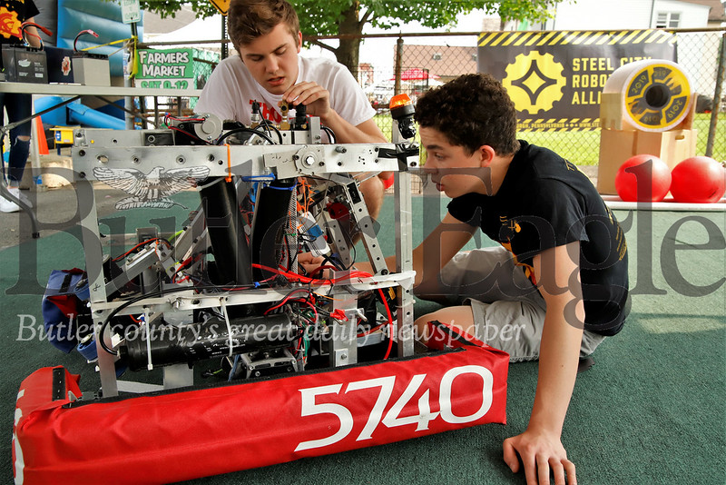 North Catholic robotics team students Dalhart Dobbs (right) and Aiden Minder assess a problem  their team's robot prior to a demonstration at this year's Mars Celebration. Seb Foltz/Butler Eagle