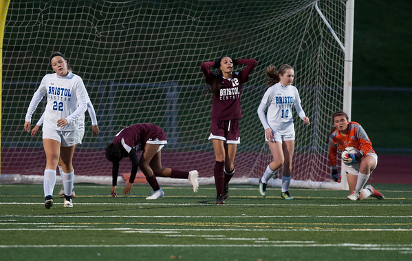 10/29/18 Wesley Bunnell | Staff Bristol Central girls soccer hosting Bristol Eastern on Monday evening. Mia Hinton (9), kneeling, and Adalia Malick (12) after Hilton's shot on goalwas saved by Goal Keeper Ava Gilbert .