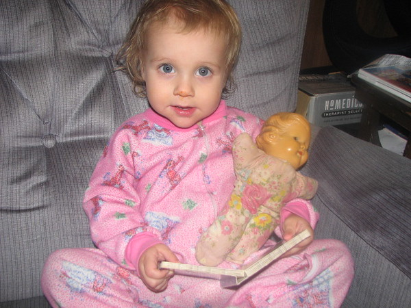 Kathryn reads to her doll (which was my doll when I was young).