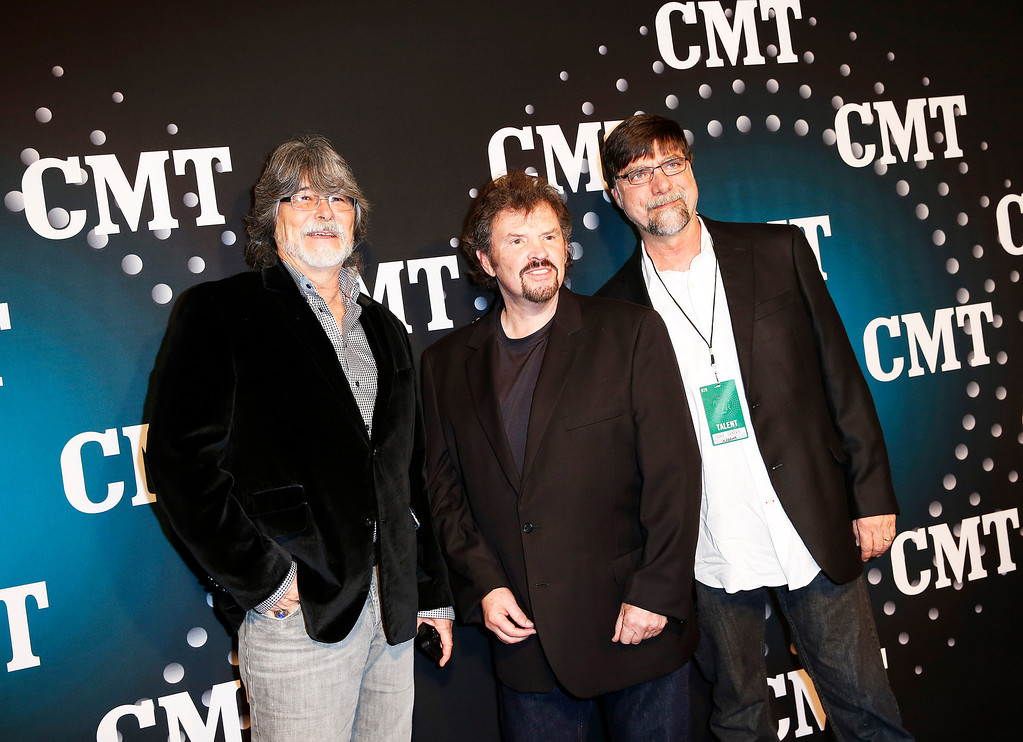 ". Alabama, from left, Randy Owen, Jeff Cook and Teddy Gentry pose on the red carpet at the CMT ""Artists of the Year\"" event at Bridgestone Arena, on Tuesday, December 3, 2013, in Nashville, Tenn. (Photo by Donn Jones/Invision/AP)"
