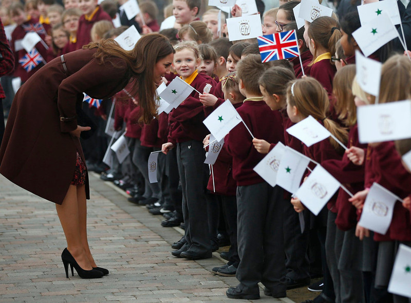 . Britain\'s Catherine, Duchess of Cambridge speaks to children during a visit to the Havelock Academy in Grimsby, northern England March 5, 2013.  REUTERS/Darren Staples