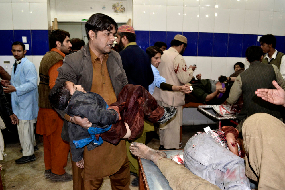 Description of . A Pakistani child who was injured in a bomb blast is brought to a hospital for treatment in Quetta, Pakistan, Thursday, Jan. 10, 2013. A bomb targeting paramilitary soldiers killed scores of people in southwest Pakistan, officials said. (AP Photo/Arshad Butt)