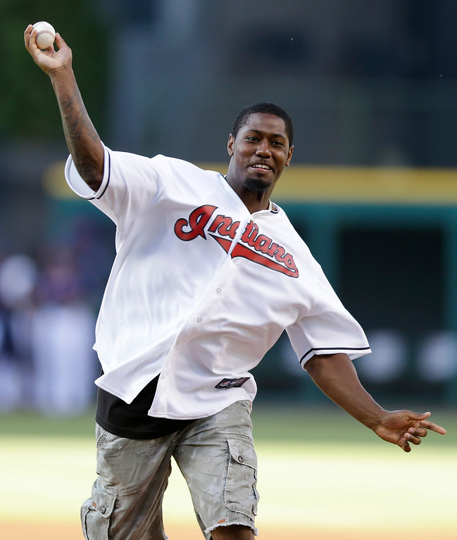 . Cleveland Browns running back Ben Tate throws out the ceremonial first pitch before the Cleveland Indians play the Boston Red Sox in a baseball game, Tuesday, June 3, 2014, in Cleveland. (AP Photo/Tony Dejak)