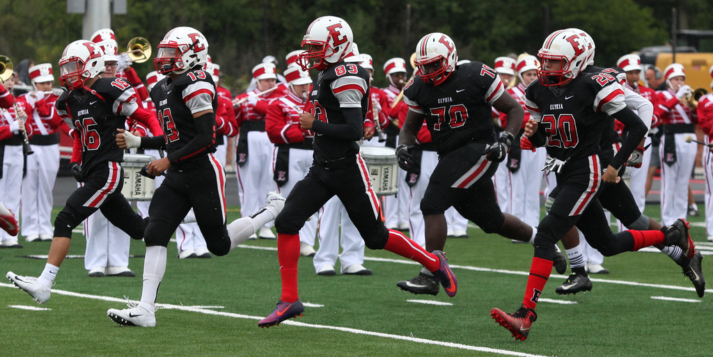 . Randy Meyers - The Morning Journal<br> The Elyria Pioneers take the field aginst Lorain on Sept. 8.