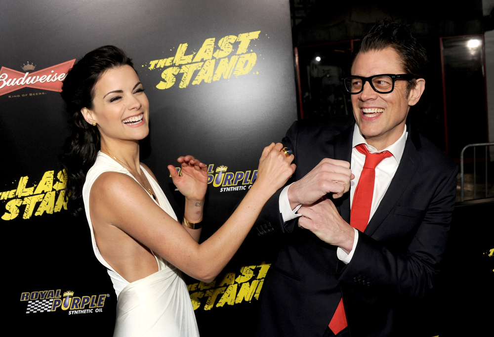 Description of . Actors Jaimie Alexander (L) and Johnny Knoxville arrive at the premiere of Lionsgate Films'