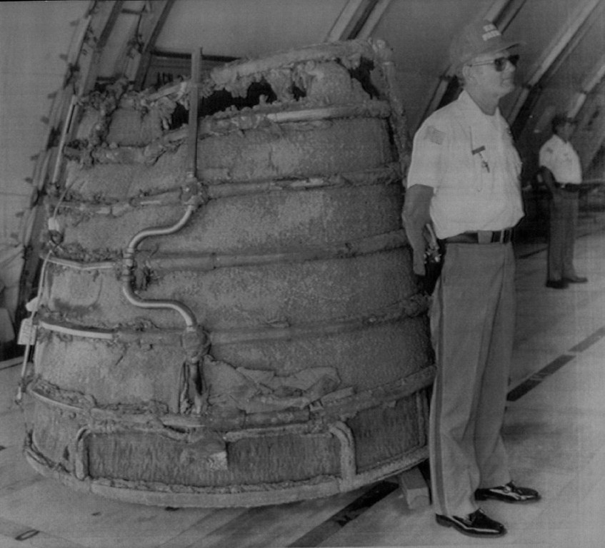. A security guard at Kennedy Space Center stands guard near the space shuttle Challenger\'s main engine bell Wednesday, April 1, 1986. The media was shown the wreckage of the Challenger for the first time today, following the January 28 explosion which took the lives of all seven astronauts.  Denver Post Library Archive