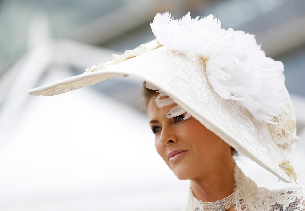 . Belinda Strudwick poses for the media on the first day of the Royal Ascot horse race meeting in Ascot, England, Tuesday, June 18, 2013. (AP Photo/Alastair Grant)