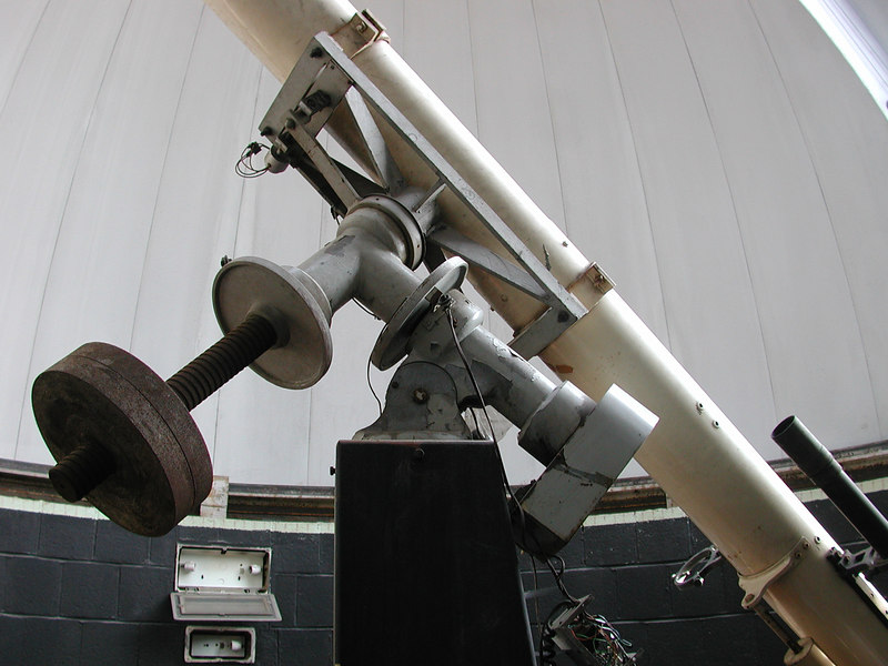 Here's a view of the equatorial mount assembly. Upon inspection I have determined this to be made by Cave Optical of Long Beach California. It was designed for their larger instruments and feaured 2-1/2 inch steel shafts. We have no idea if the Cave mounting replaced the original Mackett & Co mount or if the instrument was simply designed to incorporate the Cave mount as part of the design. It however appears to me that the Mackette tube assembly is quite a bit older than the Cave mount.