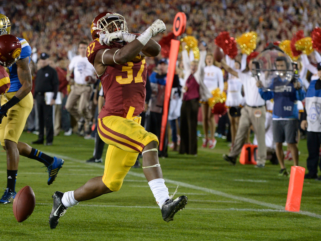 . USC Javorius Allen celebrates after scoring a Touchdown in the 2nd quarter. UCLA and USC played in a matchup of cross town rivals at the Los Angeles Memorial Coliseum in Los Angeles, CA.  photo by (John McCoy/Los Angeles Daily News)
