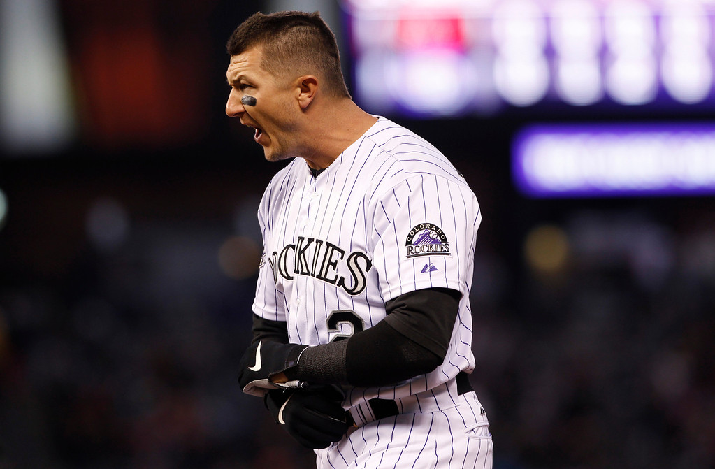 . Colorado Rockies\' Troy Tulowitzki reacts after flying out against the Arizona Diamondbacks to end the fifth inning of a baseball game in Denver on Saturday, April 20, 2013. (AP Photo/David Zalubowski)