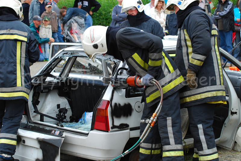 Firefighters trying to rescue someone out of a crashed car.