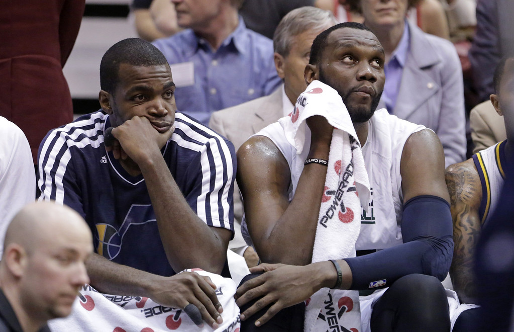 . Utah Jazz\'s Paul Millsap, left, and teammate Utah Jazz\'s Al Jefferson, right, look on after leaving the game in the fourth quarter during an NBA basketball game against the Denver Nuggets, Wednesday, April 3, 2013, in Salt Lake City. The Nuggets defeated the Jazz 113-96.  (AP Photo/Rick Bowmer)