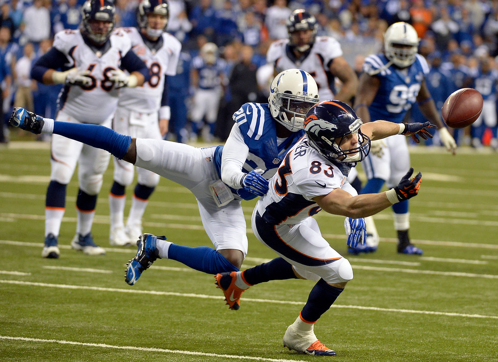 . Denver Broncos wide receiver Wes Welker (83) can\'t handle a Peyton Manning pass as Indianapolis Colts free safety Darius Butler (20) covers him on the play during the fourth quarter October 20, 2013 at Lucas Oil Field. Photo by John Leyba/The Denver Post)
