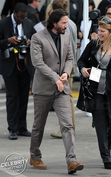 Keanu Reeves Shows Off Salt and Pepper Beard In Smart Suit, LA