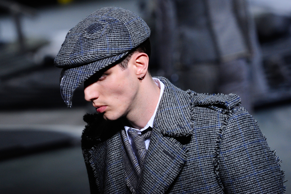 . A model presents a creation as part of American fashion designer Thom Browne\'s men\'s Fall-Winter 2014-2015 fashion collection, presented Sunday, Jan. 19, 2014 in Paris. (AP Photo/Zacharie Scheurer)