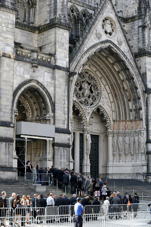 . People walk into Cathedral Church of Saint John the Divine during for funeral services actor James Gandolfini, Thursday, June 27, 2013, in New York.  (AP Photo/Julio Cortez)