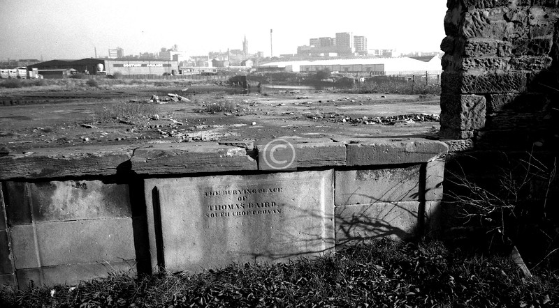 A scene of desolation beyond the west wall of the churchyard. Neat new housing now.   April 1975
