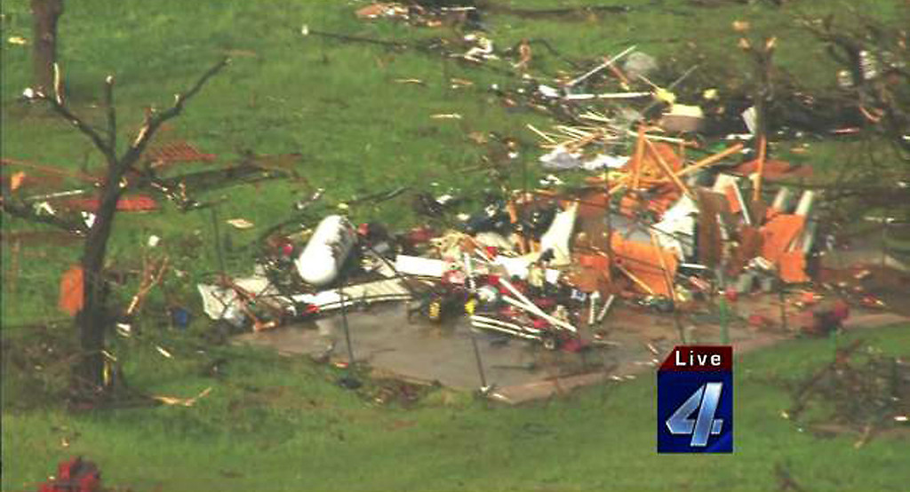 . Damaged structures are seen May 19, 2013 after a tornado ripped through Wellston, Oklahoma. Tornadoes damaged many areas across the state May 19, 2013 and are still forming.  Homes have been destroyed, with the worst damage so far just outside of Wellston.   AFP PHOTO / KFOR-TV