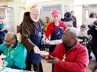 Cardinal visits Pine Street Inn on Christmas Eve 2018