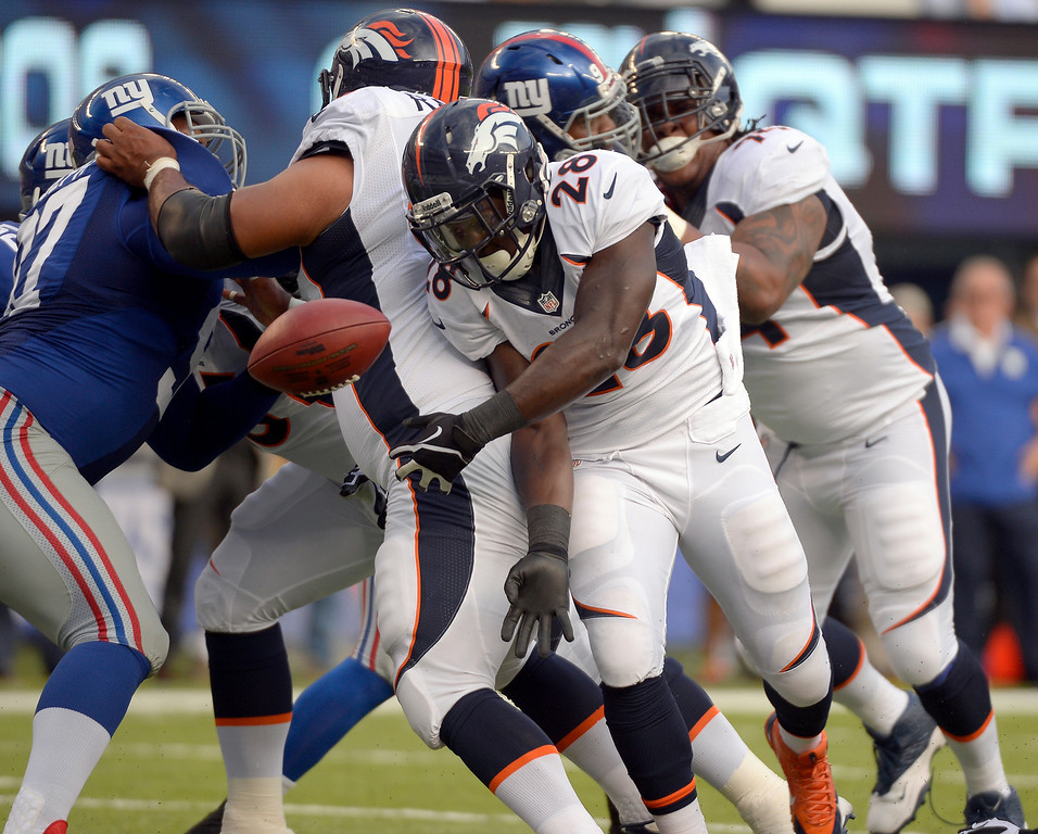 . Running back Montee Ball (28) of the Denver Broncos fumbles the ball at the 3 yard line and recovered by the New York Giants September 15, 2013 MetLIFE Stadium. (Photo by John Leyba/The Denver Post)