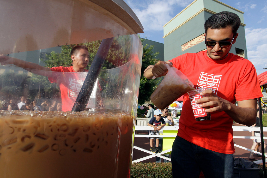 . The world\'s largest boba cup, at approximately 320 gallons, is served to the crowd at the 626 night market at Santa Anita Park in Arcadia, Saturday August 3, 2013. (SGVN/Correspondent Photo by Ron Fu/SVCITY)