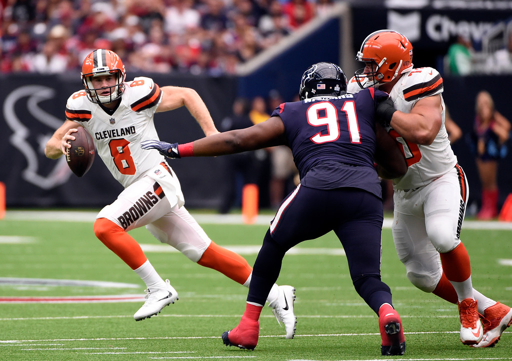 . Cleveland Browns quarterback Kevin Hogan (8) scrambles before throwing a pass under pressure from Houston Texans defensive tackle Carlos Watkins (91) in the first half of an NFL football game, Sunday, Oct. 15, 2017, in Houston. (AP Photo/Eric Christian Smith)