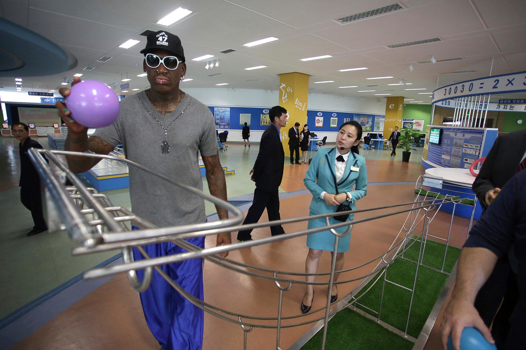 ". Former NBA basketball star Dennis Rodman visits the Sci-Tech Complex on Wednesday, June 14, 2017, in Pyongyang, North Korea. Rodman who has palled around with North Korean leader Kim Jong Un, began sightseeing in Pyongyang on Wednesday during a trip he said he hoped would ""open a door\"" for his former \""Celebrity Apprentice\"" boss - President Donald Trump. (AP Photo/Kim Kwang Hyon)"