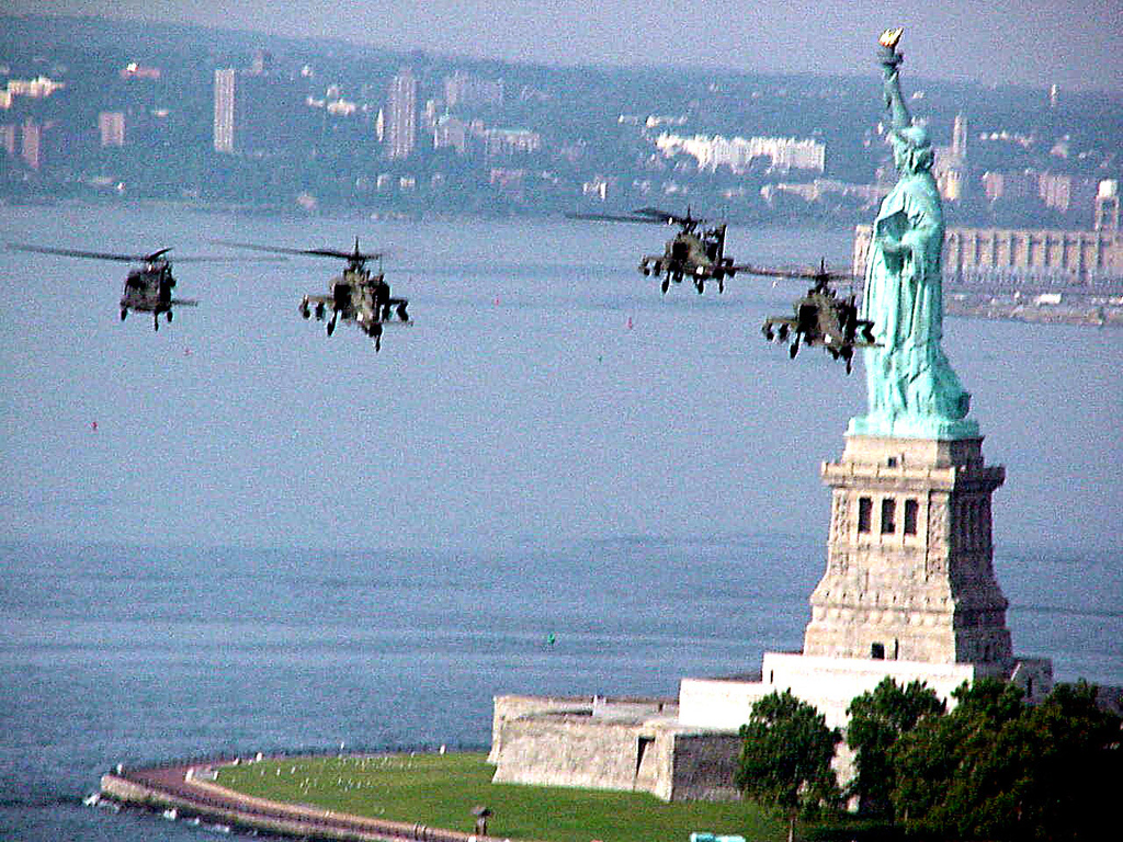 . Apache helicopters of the 8th/229th fly past the Statue of Liberty on their way to Bosnia via Staten Island, N.Y., where they were loaded onto a cargo ship August 4, 1999.  (Photo by U.S. Army via Newsmakers)