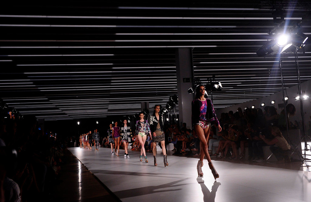 . Models wear creations from Custo Barcelona during a 080 Barcelona fashion show in Barcelona, Spain, Wednesday, July 10, 2013.  (AP Photo/Manu Fernandez)