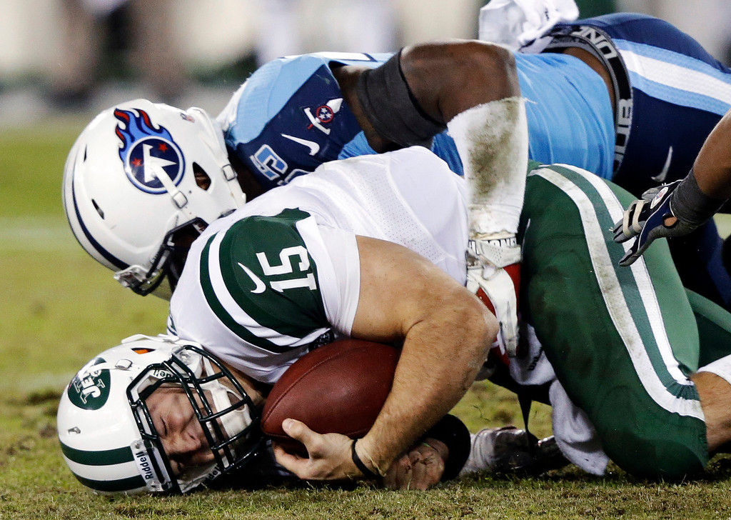 . New York Jets quarterback Tim Tebow (15) is sacked for a 2-yard loss by Tennessee Titans linebacker Zach Brown (55) in the second quarter of an NFL football game, Monday, Dec. 17, 2012, in Nashville, Tenn. (AP Photo/Wade Payne)
